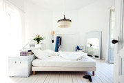 A white, airy bedroom in the French countryside