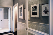 Antiqued-mirror panels on a white door