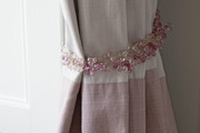 Feminine pink curtain tie back.