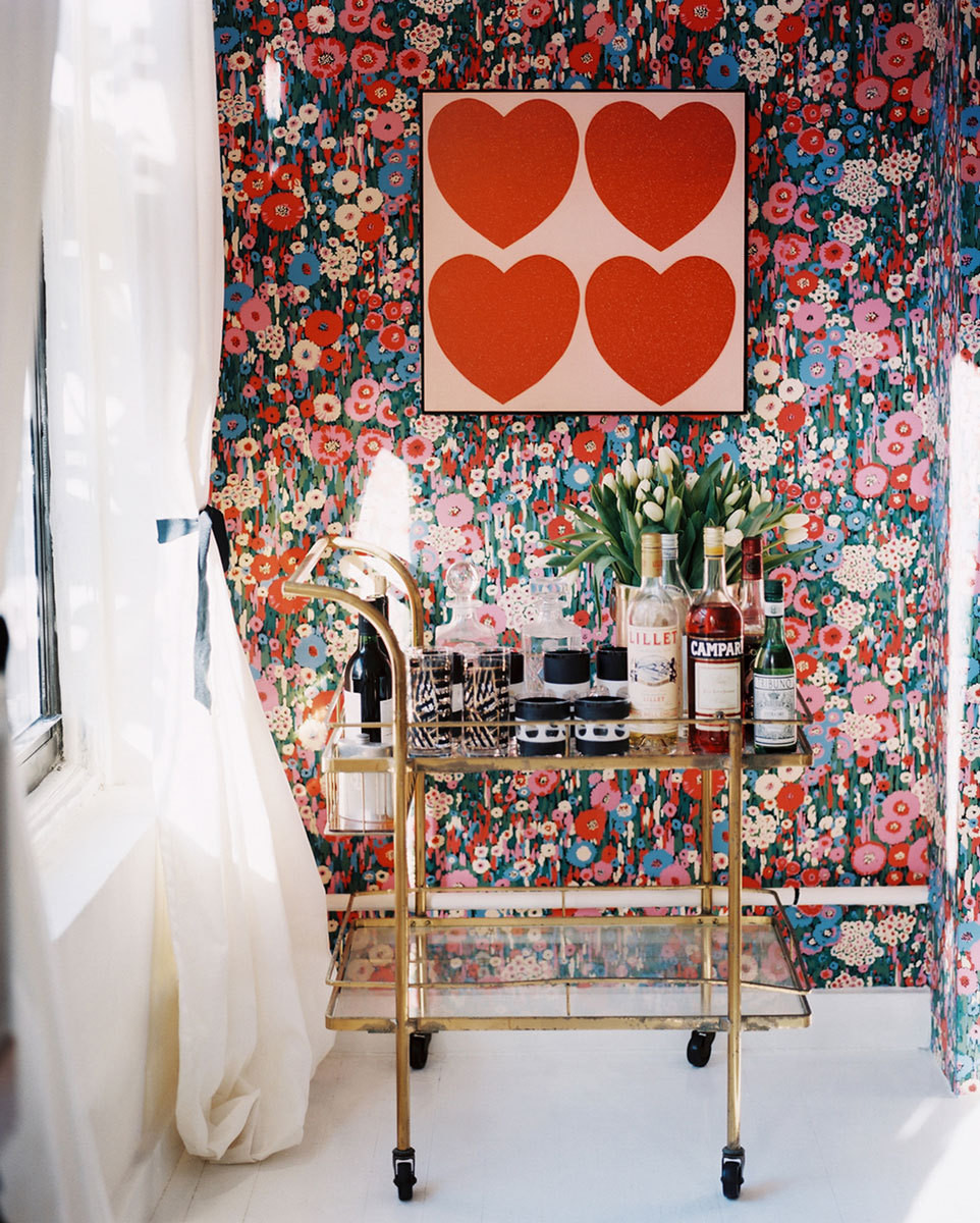 An Andy Warhol print provides playful contrast to the vintage Bob Collins & Sons floral wallpaper.
