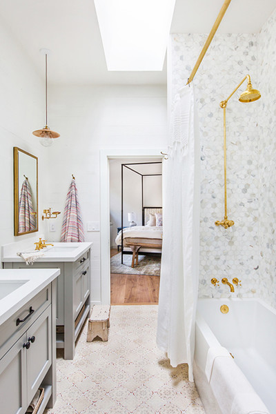 Go Metallic - 16 Showers That Give Us Serious Bathroom Envy - Lonny