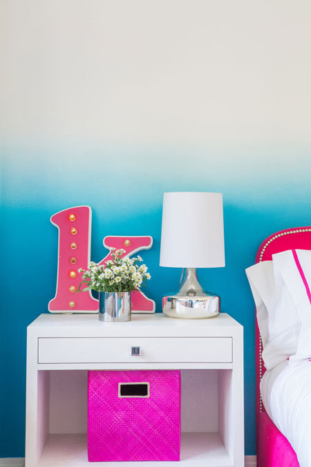 Bungalow 5's Frances 2-Drawer Side Table serves as a nightstand.