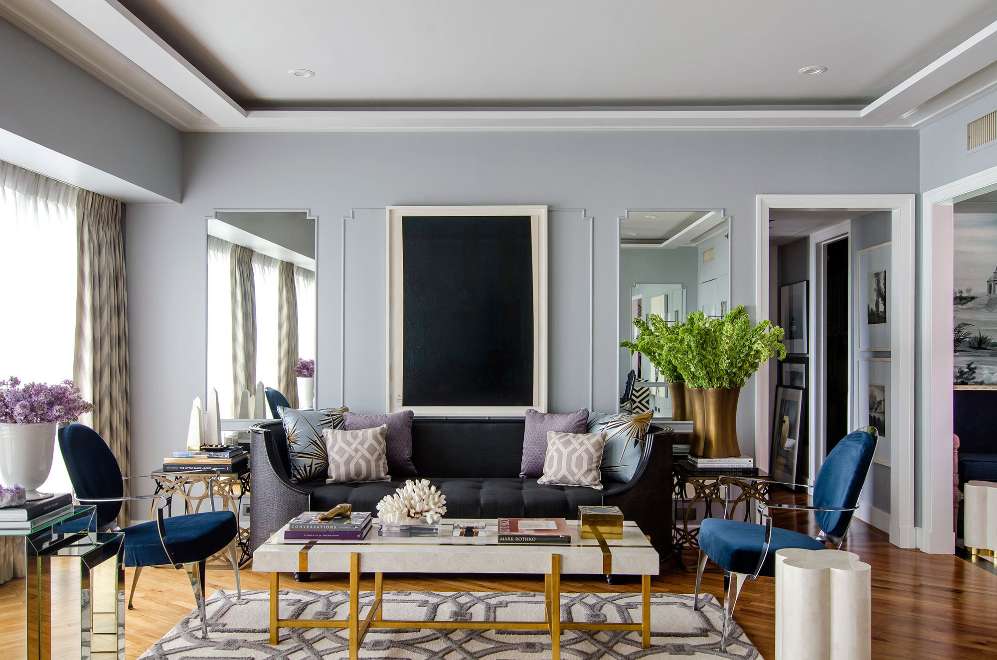 A brass-and-stone cocktail table of his own design takes center stage at the home of Blue Carreon in Manila, Philippines.