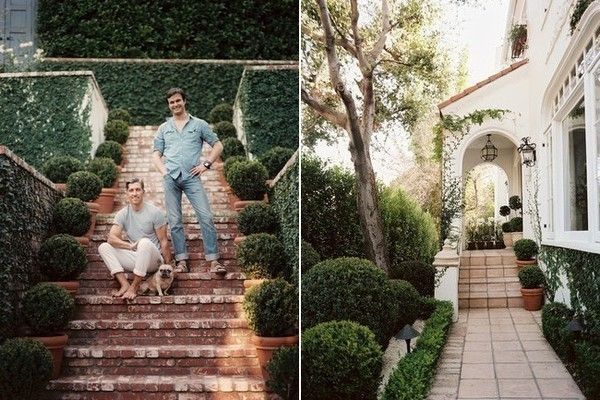 At left, Sikes, Griffin and their French bulldog, Lily, amid the topiary-lined brick steps of their lush garden. At right, the front door of the couple's 1920s, Spanish-influenced home exudes romantic Mediterranean style.