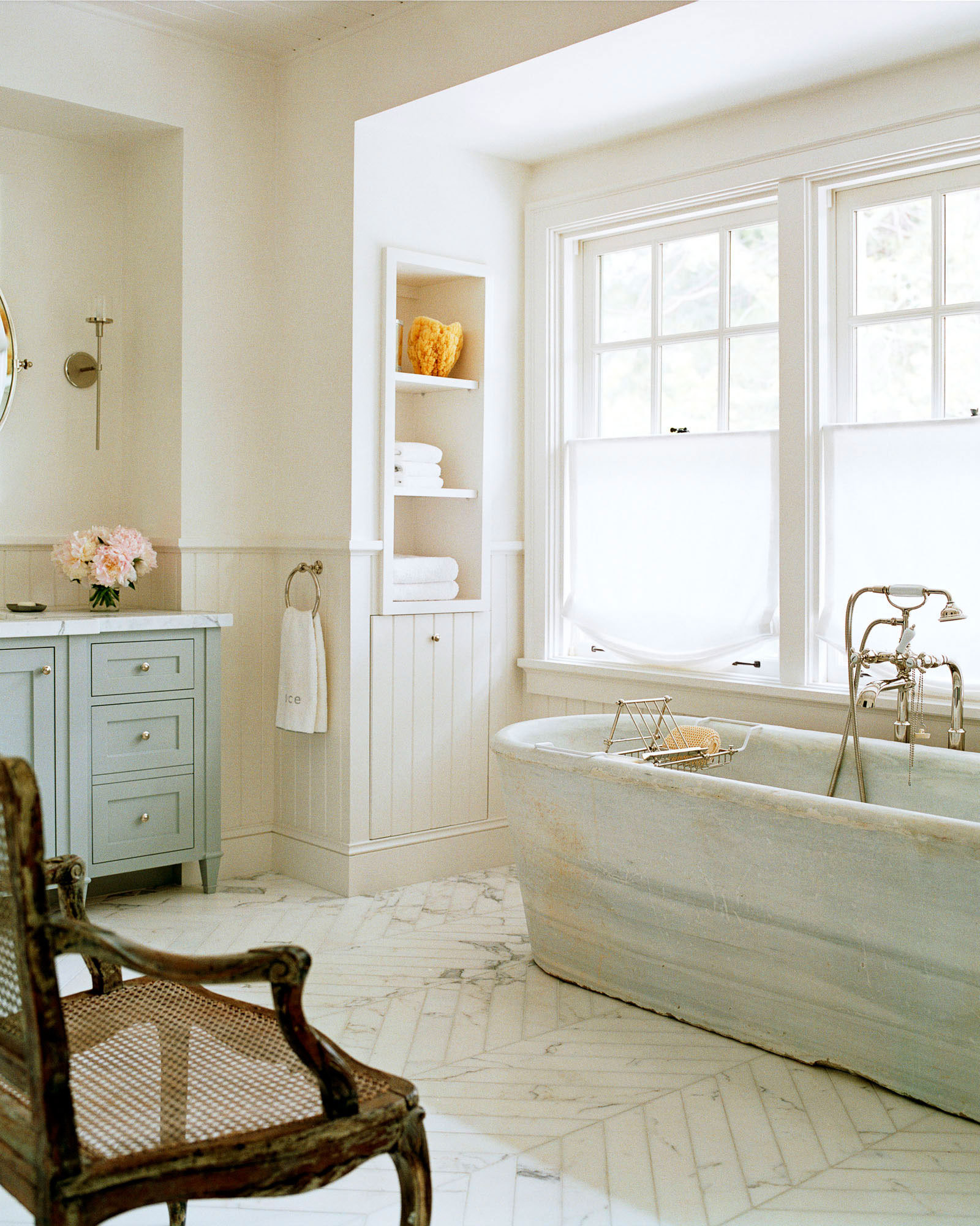 An antique marble tub sourced from a crumbling French château takes pride of place in the master bathroom.