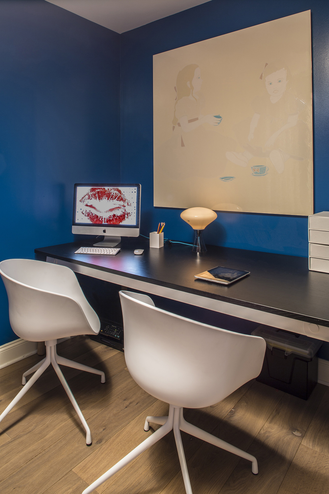 The study (above) and daughter Grace's room (left) balance saturated color with sleek, midcentury-inflected furnishings.