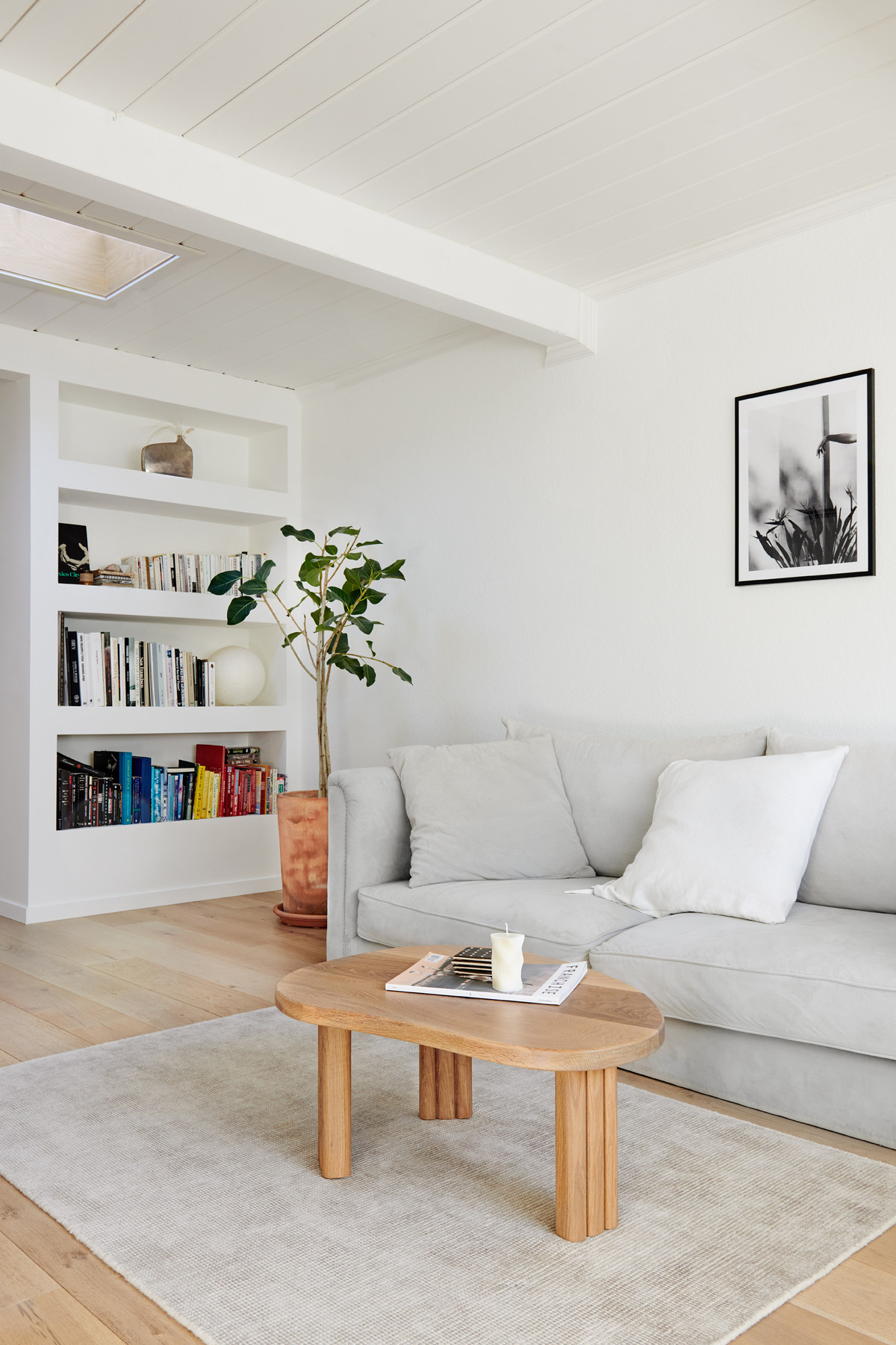 The living room is accented with a handmade bean-shaped coffee table byJosh Podoll.
