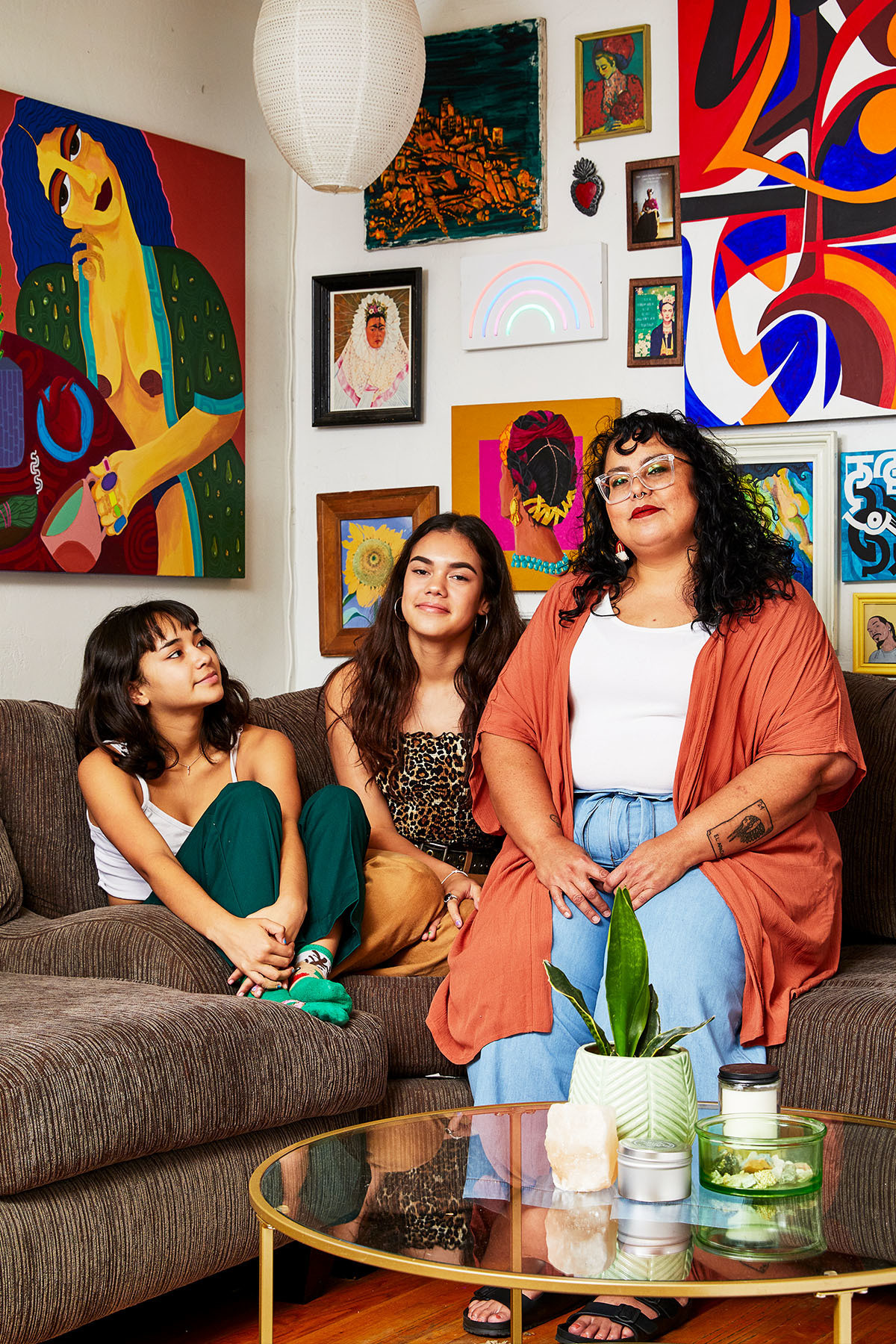 """I want (my children) to see me as a person who fiercely loves them and raised them at home, but also never lost sight of who she was as a person — and as an artist,"" explains Cortes, pictured here with daughters Xiomara (far left) and Maya. Habitat For Humanity Vintage Coffee Table."