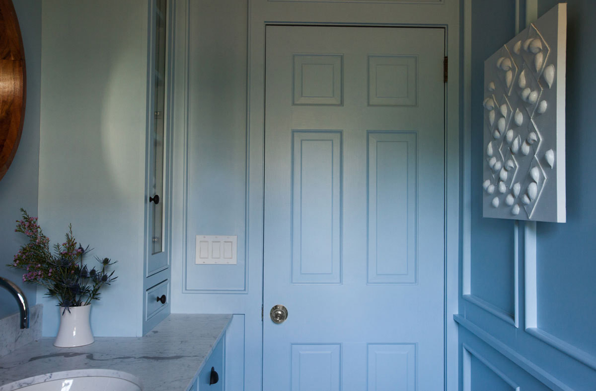 Even the inside of the door was given a coat ofSherwin Williams's Take Five, a dusty pale blue.