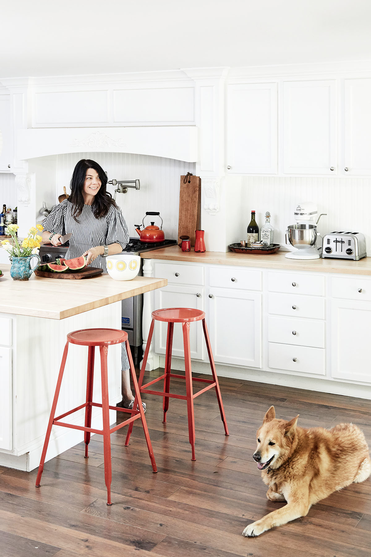 """A lazy day, for me, is very domestic,"" Gran admits, pictured here with the beloved family dog, Foxy. ""That means never leaving the house. I&squot;ll gather eggs, pick flowers, fruit and herbs, and make something delicious and organic — like preserved lemons or pickled grapes."" Benjamin Moore Decorator&squot;s White Paint 
