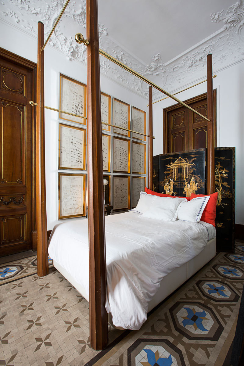 The guest bedroom's oak-and-brass bed was designed by Contemporain Studio.