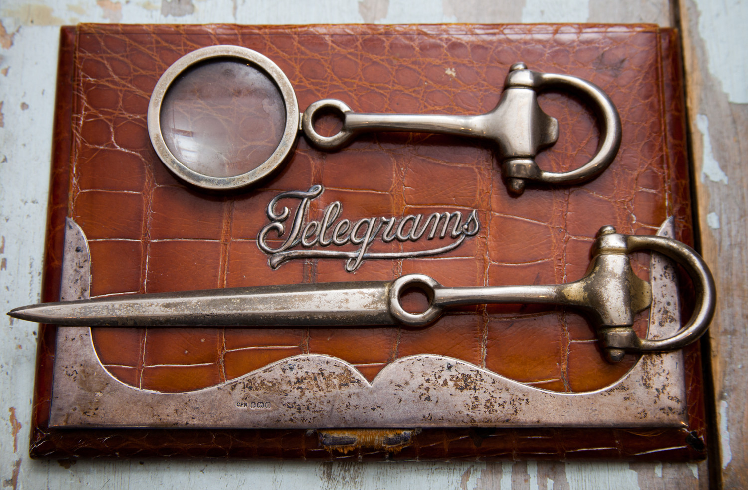 Antique desk accessories boast equestrian accents and a perfect patina.