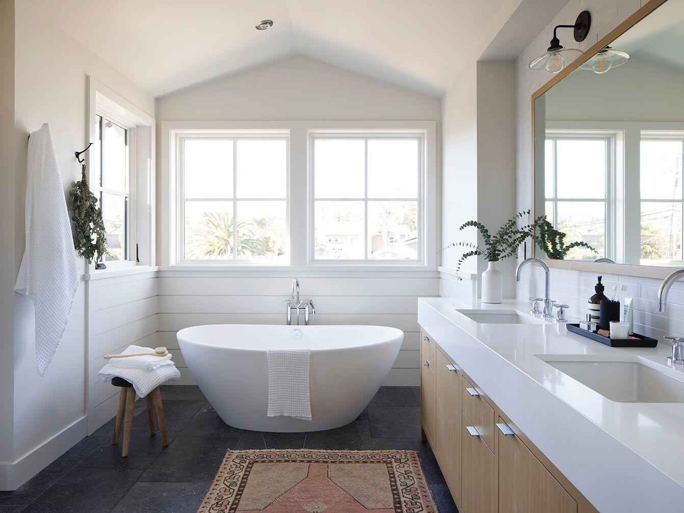 The master bath features a stand-alone tub and is flooded with natural light.