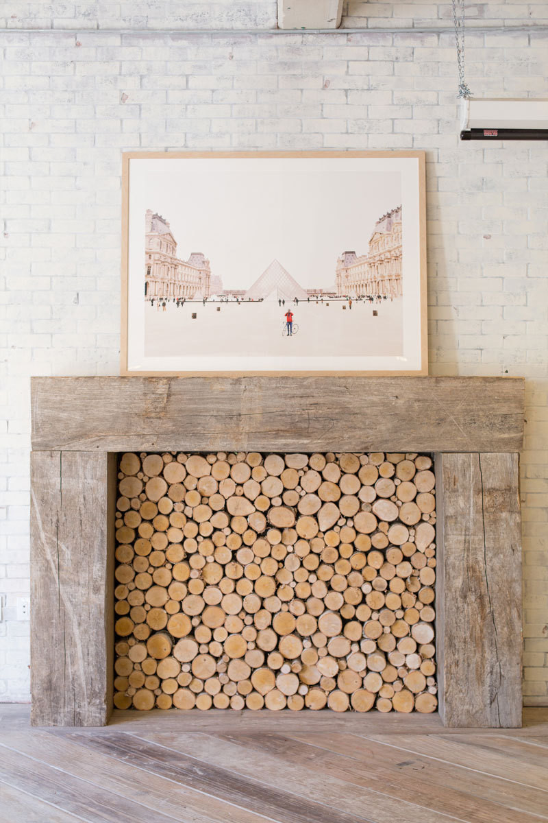 Surprisingly, the brick wall surrounding the non-working fireplace isn't original to the space. The duo called on Brick It to install just the surface of whitewashed bricks.