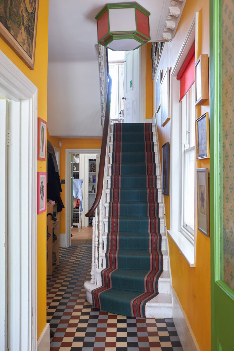The citrus-hued entrance hall is a nod to FitzGerald's Glin Castle.