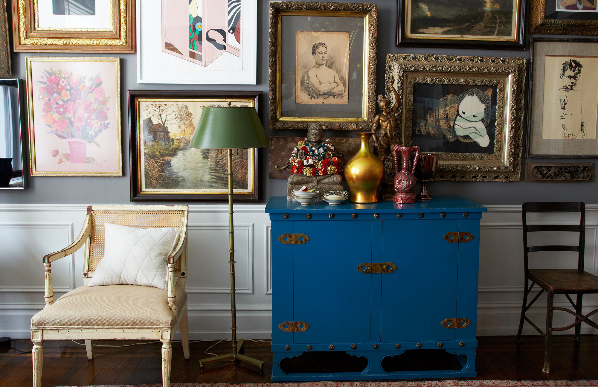 A maximalist aesthetic rules in the living room of James Klein and David Reid.