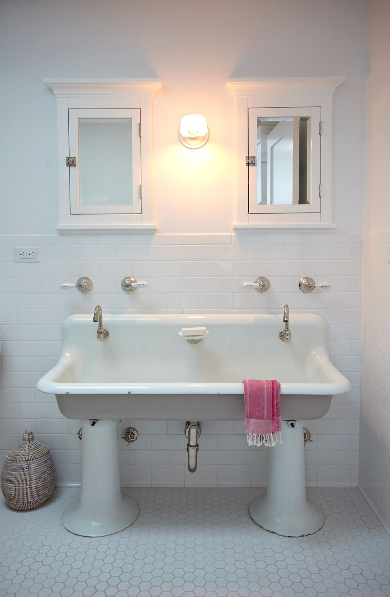 An old trough sink was refinished for the kids' bathroom.