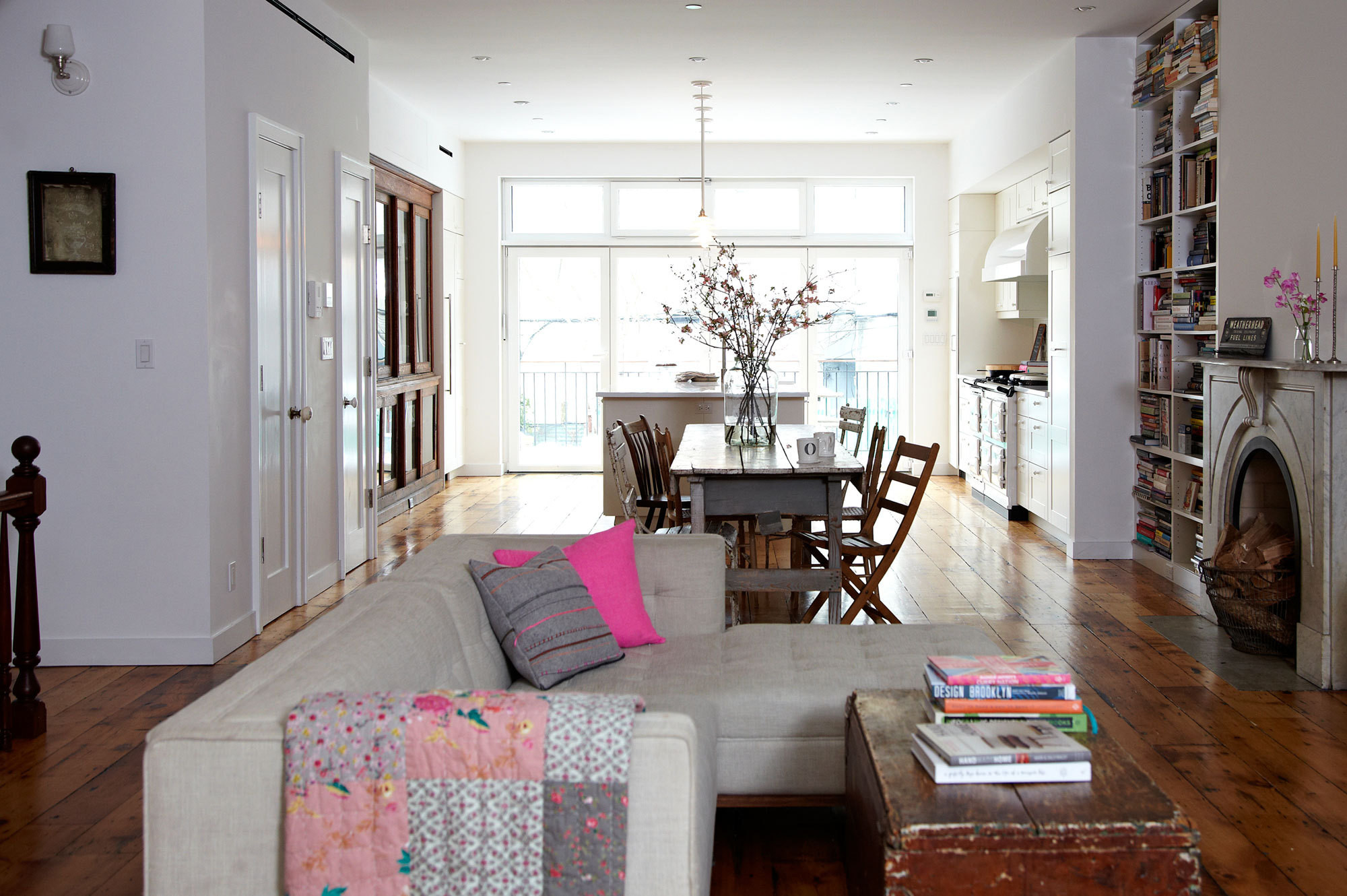 The open-plan parlor level of Odette Williams and Nick Law's residence encompasses living and dining spaces and a luminous kitchen.