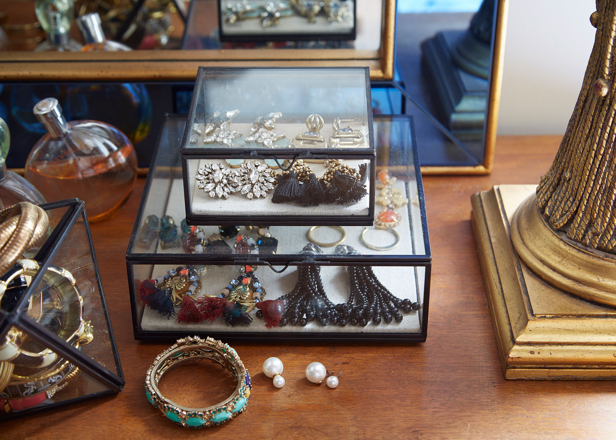 Shadow boxes display a colorful collection of jewelry.