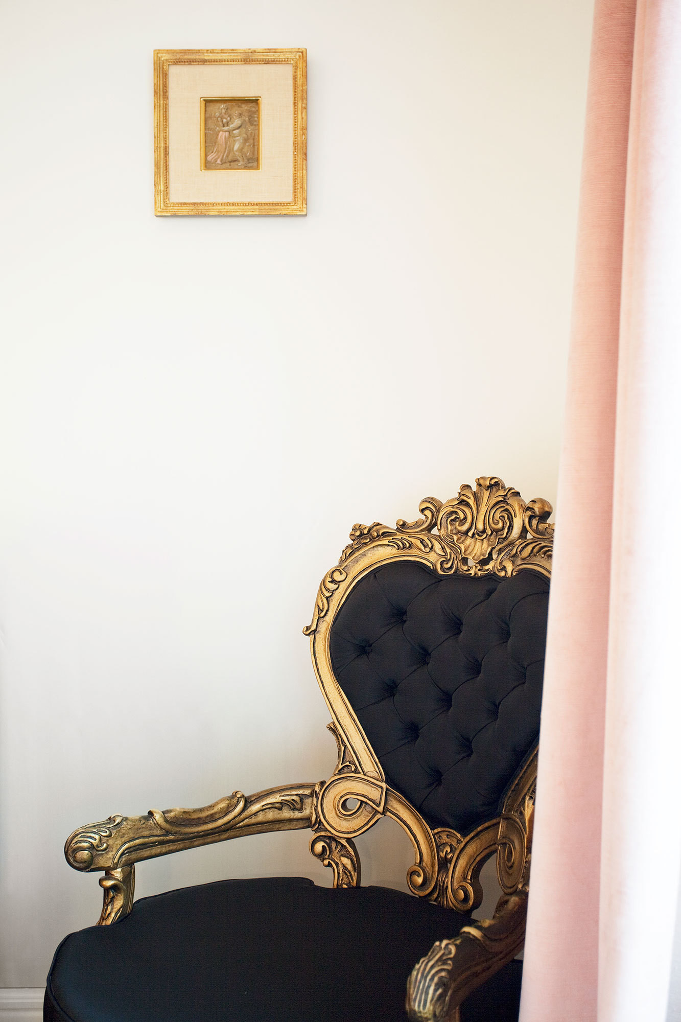 A Victorian tufted heart-back chair is upholstered in black silk.