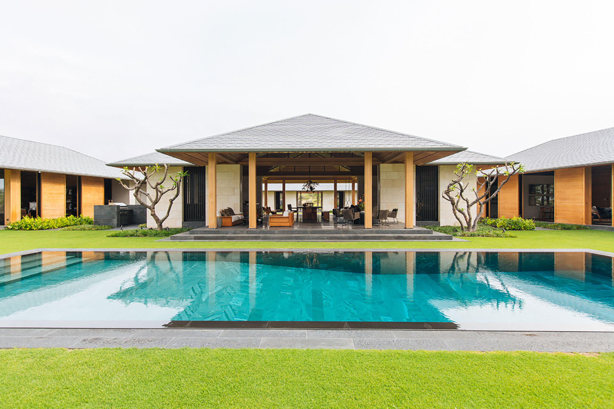 For a family with personal ties to Hawaii's Kona coast, designer Nicole Hollis created a series of open pavilions inspired by traditional Hawaiian architecture.