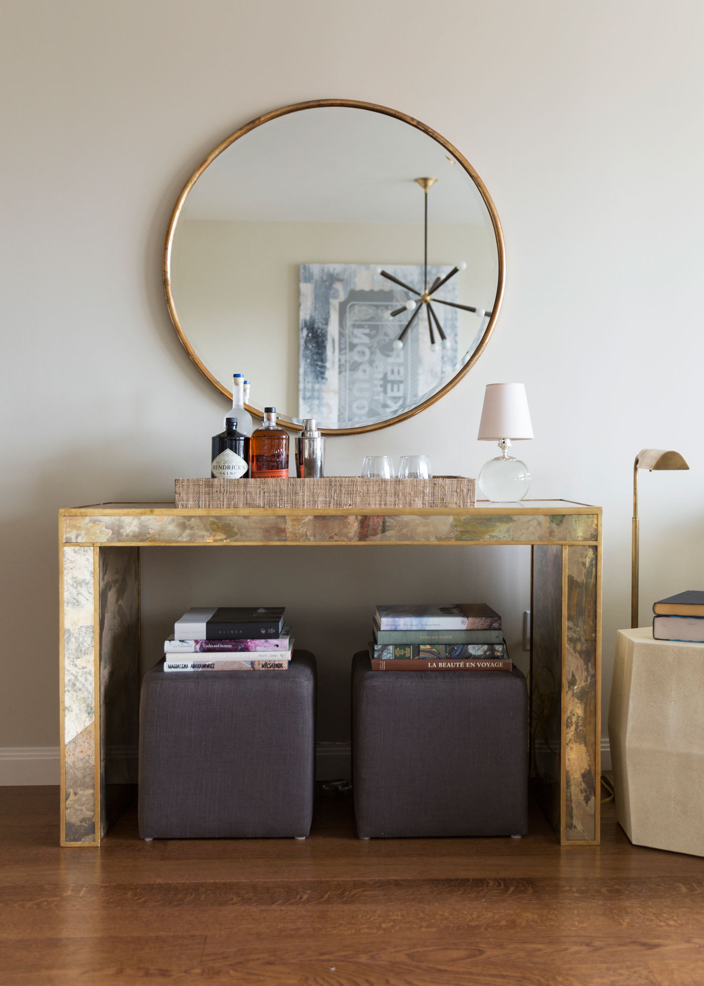 A mirrored console creates a striking sense of welcome—and doubles as a bar for entertaining.