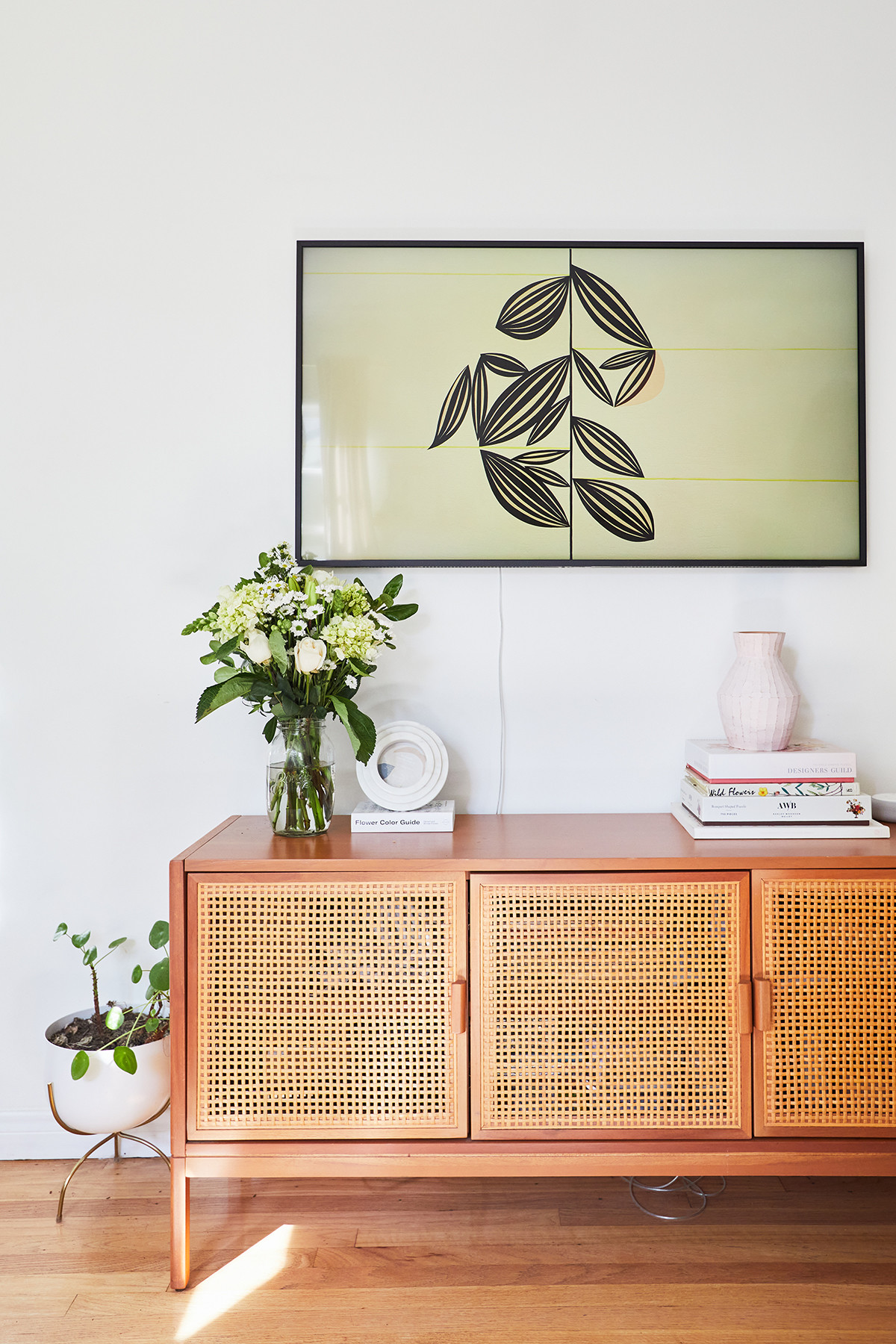 "With such a bright interior, Hewitt wanted the design to be ""plant-focused"" and create a space that&squot;s ""full of life."" Urban Outfitters Media Console 