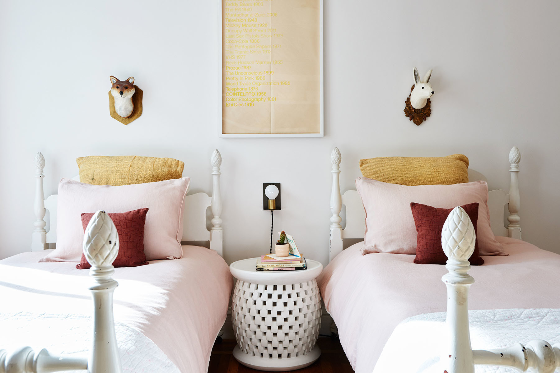 """The girls beds were originally my great grandparents beds,"" says Martinez. ""They were custom-made to be extra long since my great grandfather was very tall."" Serena & Lily Stool 