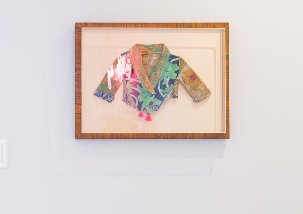 Okay, we must know more about this adorable framed jacket…