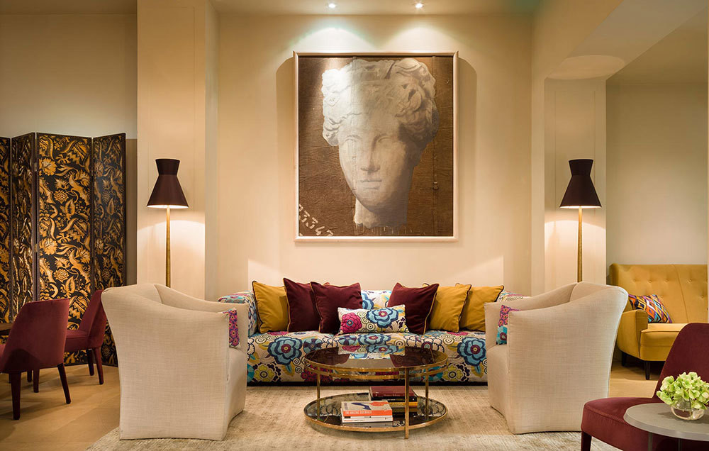 The new design of the lobby in the Hotel Savoy places contemporary furniture silhouettes alongside playful nods to Italian tradition.