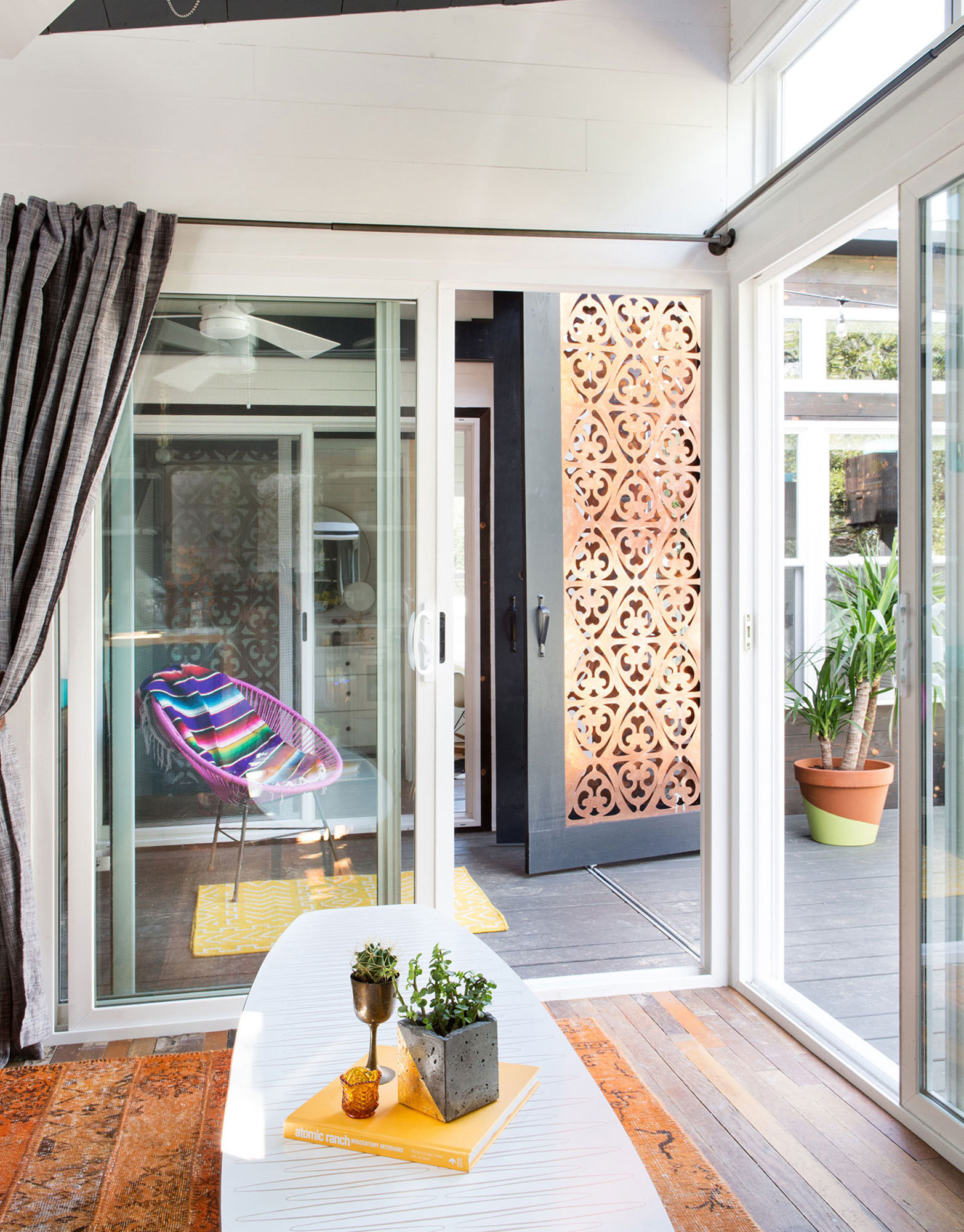 Sliding doors turn the deck into a true extension of the home.