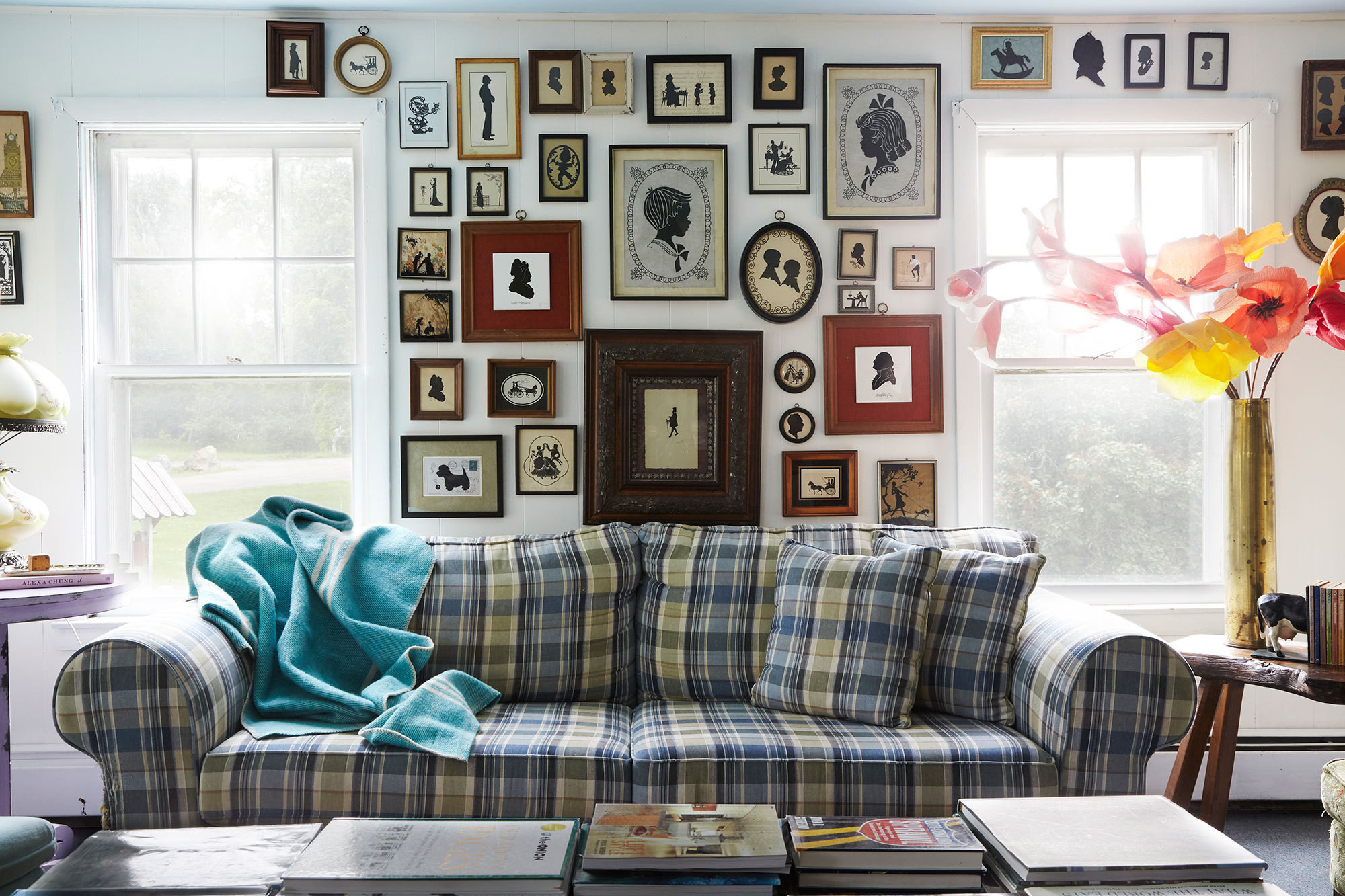 A collection of cameo portraits dominates the living area in the guesthouse of Tata Harper's Vermont farm.