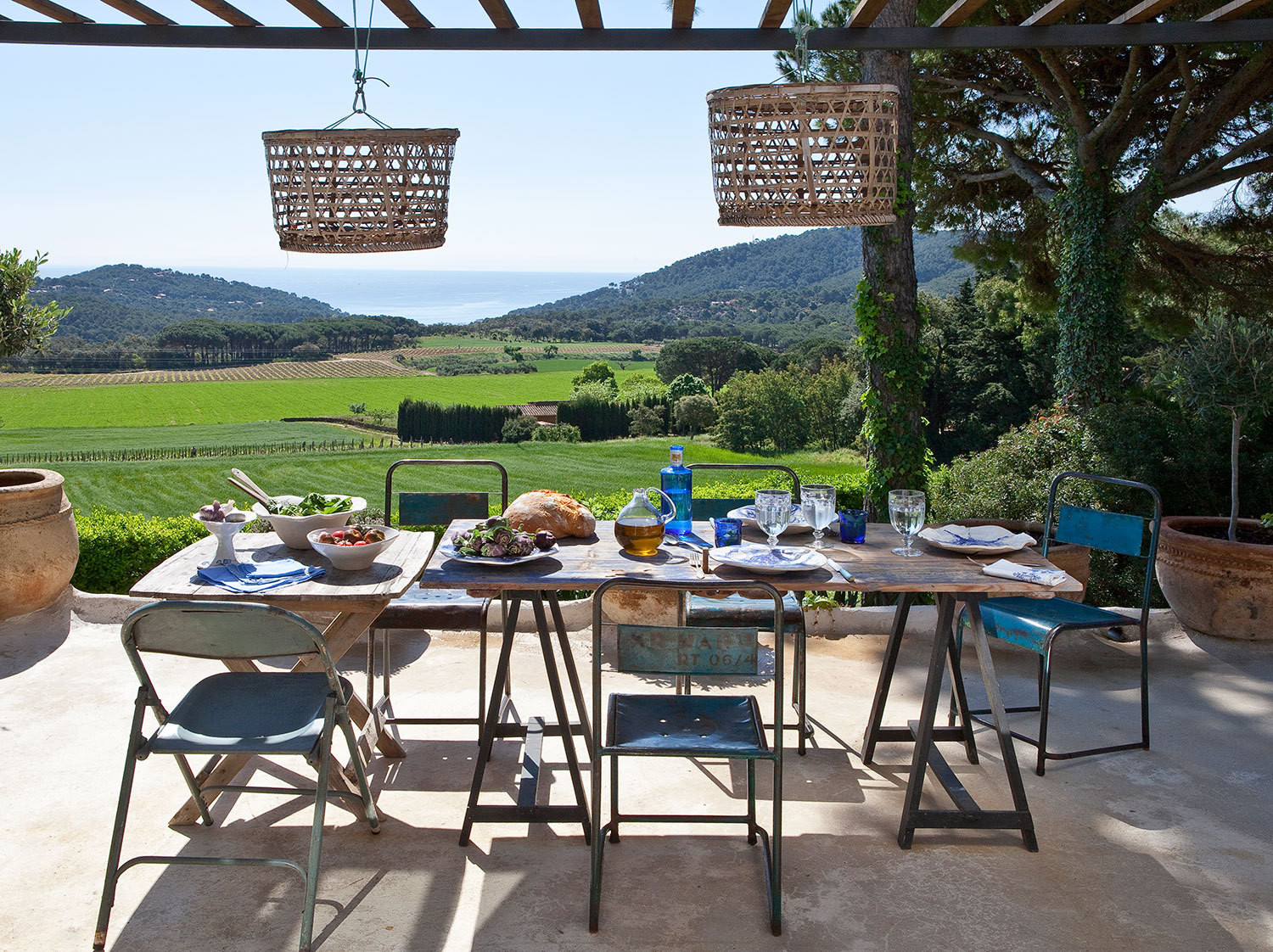 The dining terrace looks out on the Costa Brava landscape and Mediterranean Sea.