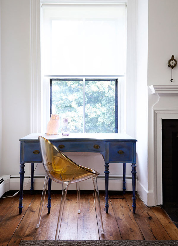 A Kartell chair exists in mod contrast to the home's original features.