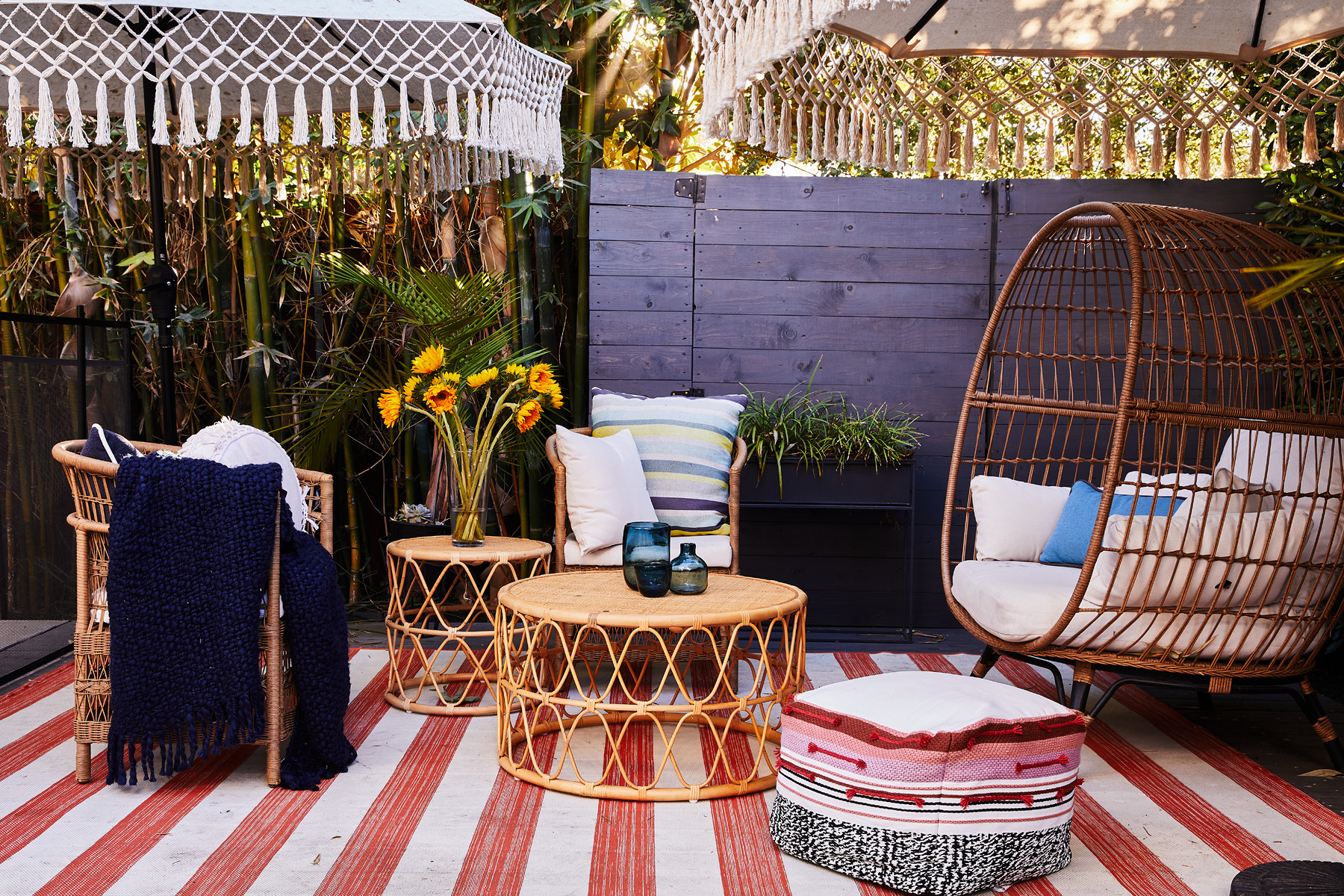 TheCali-cool scene is set with this bright and Bohemian patio design that's made for entertaining and family dinners in the warm L.A. air.TargetOpalhouseEgg Chair |Target Threshold Patio Chair |Target Opalhouse Coffee and Side Table Set |Target Rug |World Market Patio Umbrella |Target Pouf.