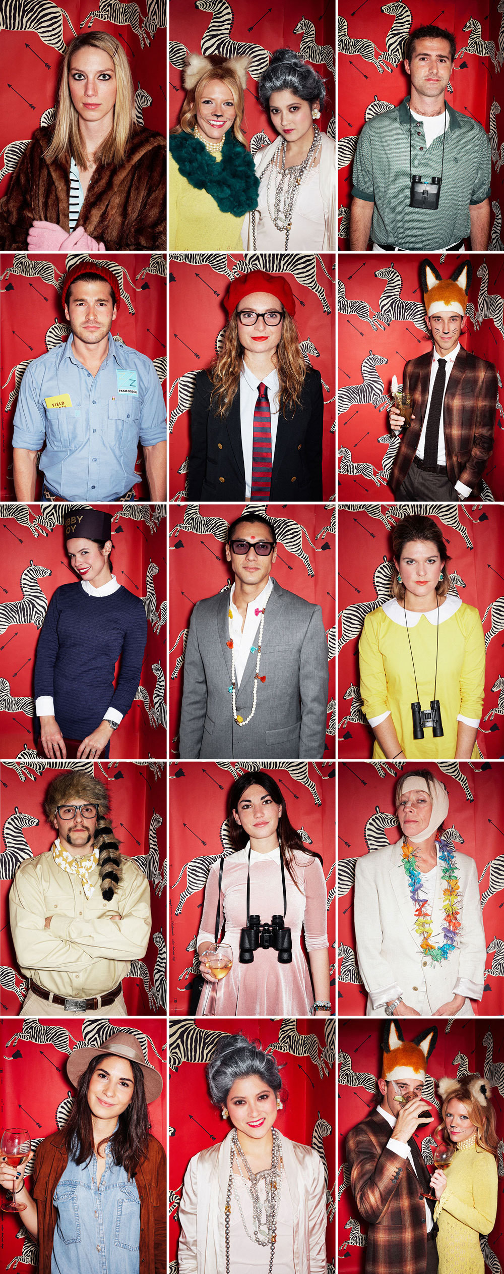 Guests strike a pose as their cinematic doppelgangers in a photo booth lined with Scalamandré wallpaper .