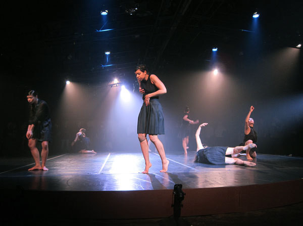 The Cedar Lake dancers perform on a central round stage surrounded by the audience.