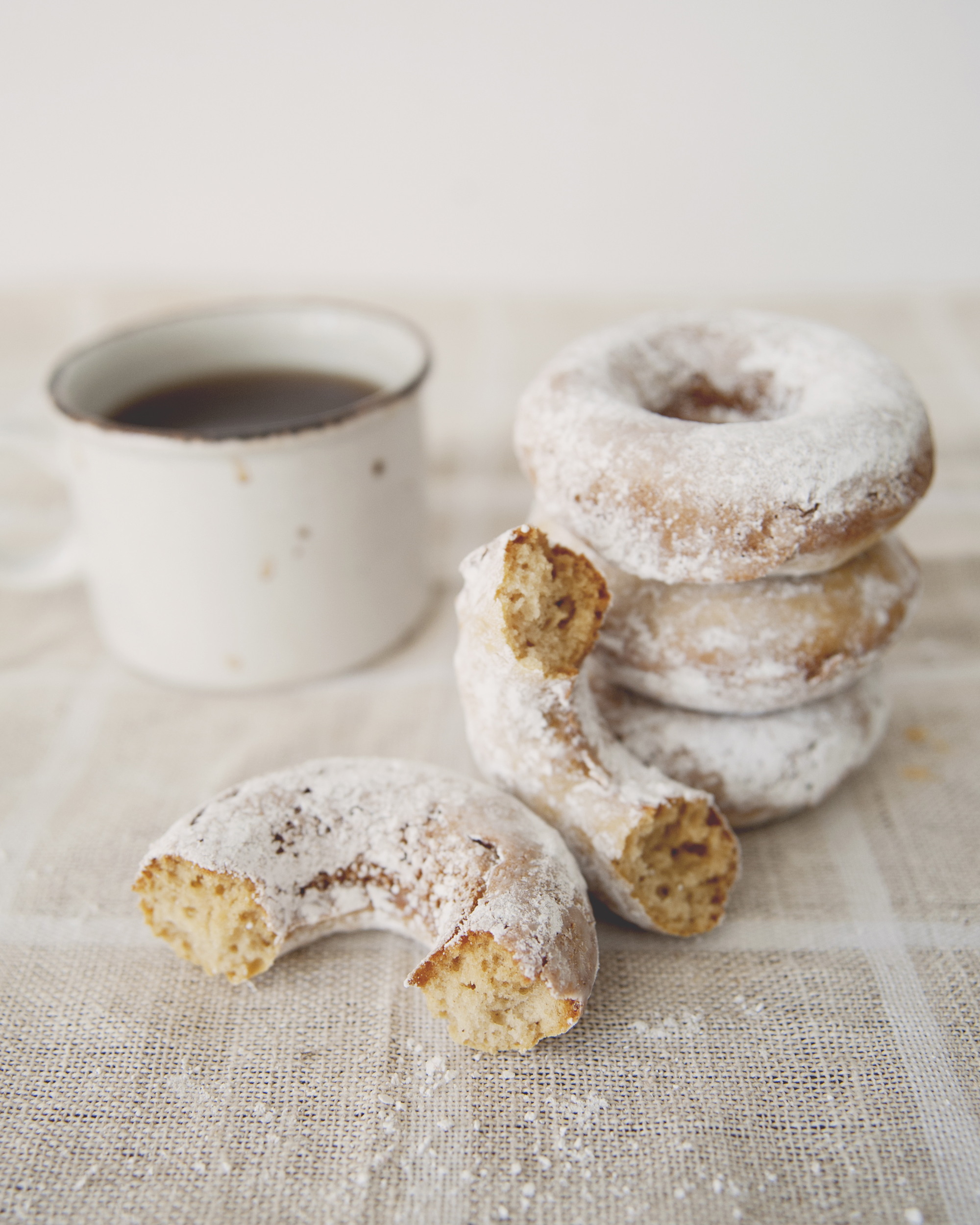 Sour milk doughnuts, dusted with sugar.