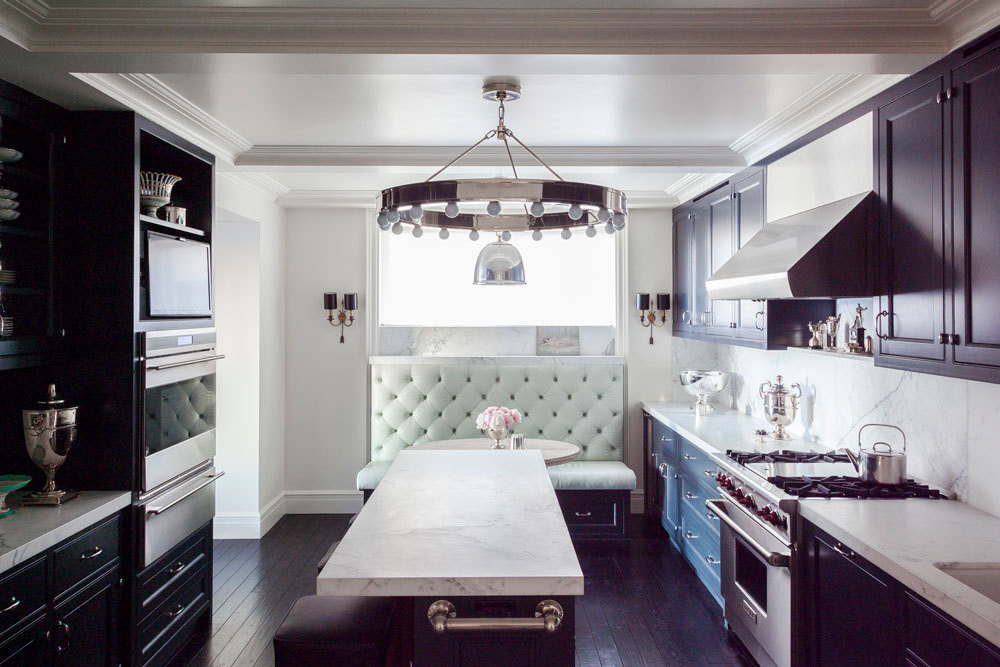 A fashion spread in a French magazine inspired the tufted kitchen banquette in a cool hue.