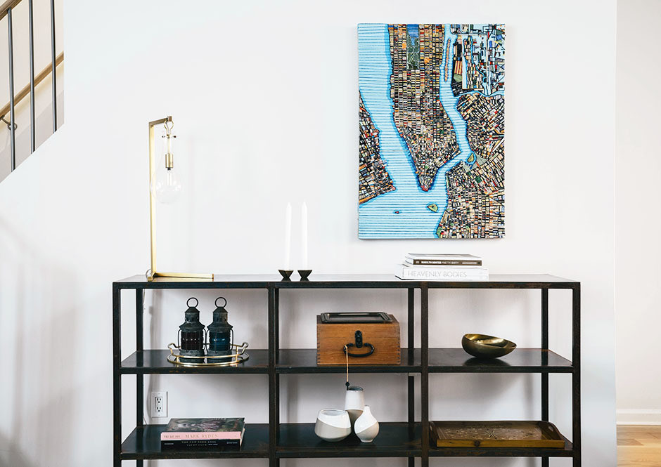 Upon entry, a piece by Ruben Marroquin decorates the white walls. Benjamin Moore Paint | Canvas Home Credenza | Arteriors Lamp | Jill Plattner Candlesticks | Vintage Lock Box | West Elm Bud Vases.