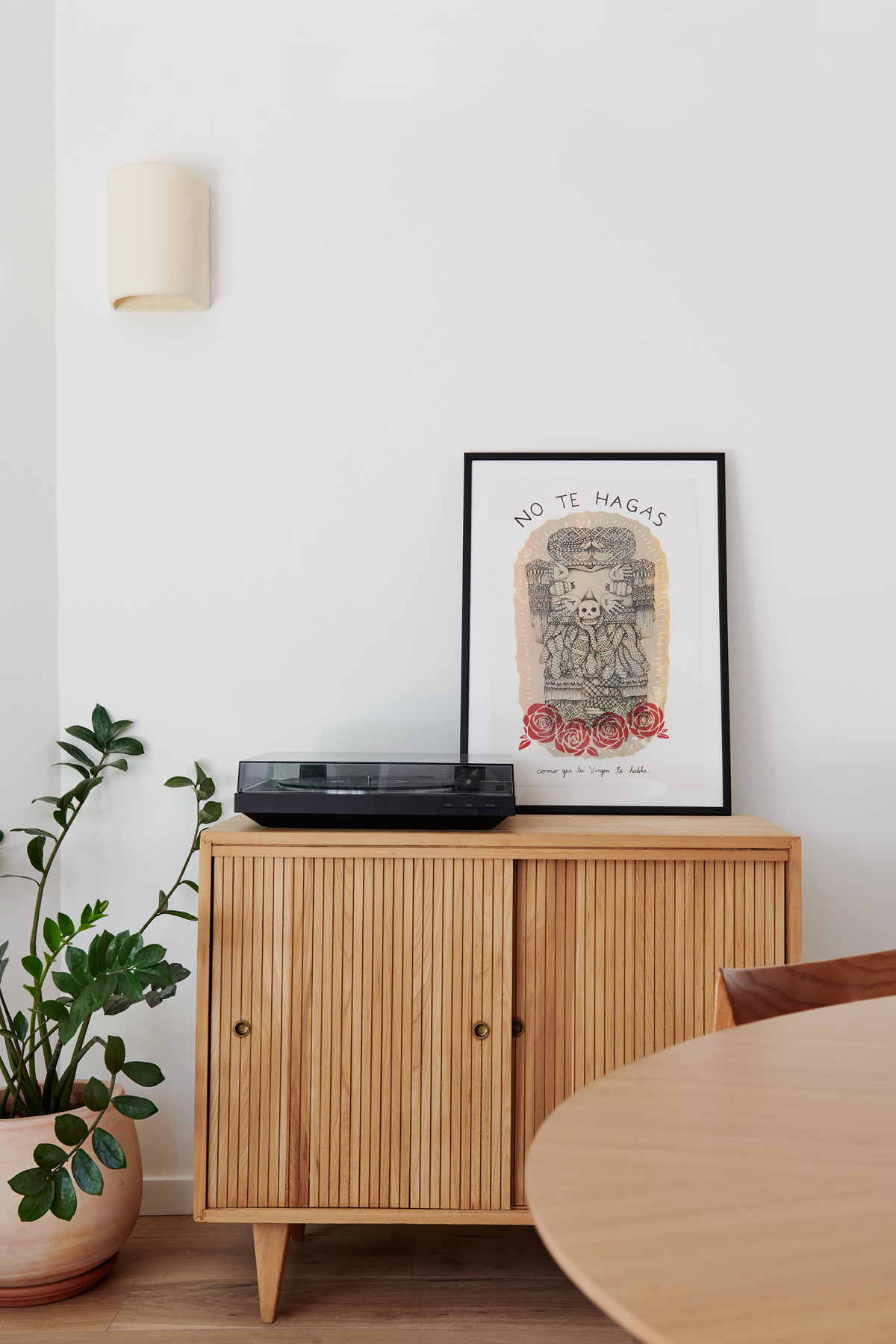 Artwork by del Rio's sister is proudly perched on the credenza sourced via Craigslist — while a ceramic lighting fixture, which del Rio acquired in New Mexico, sits next to it.