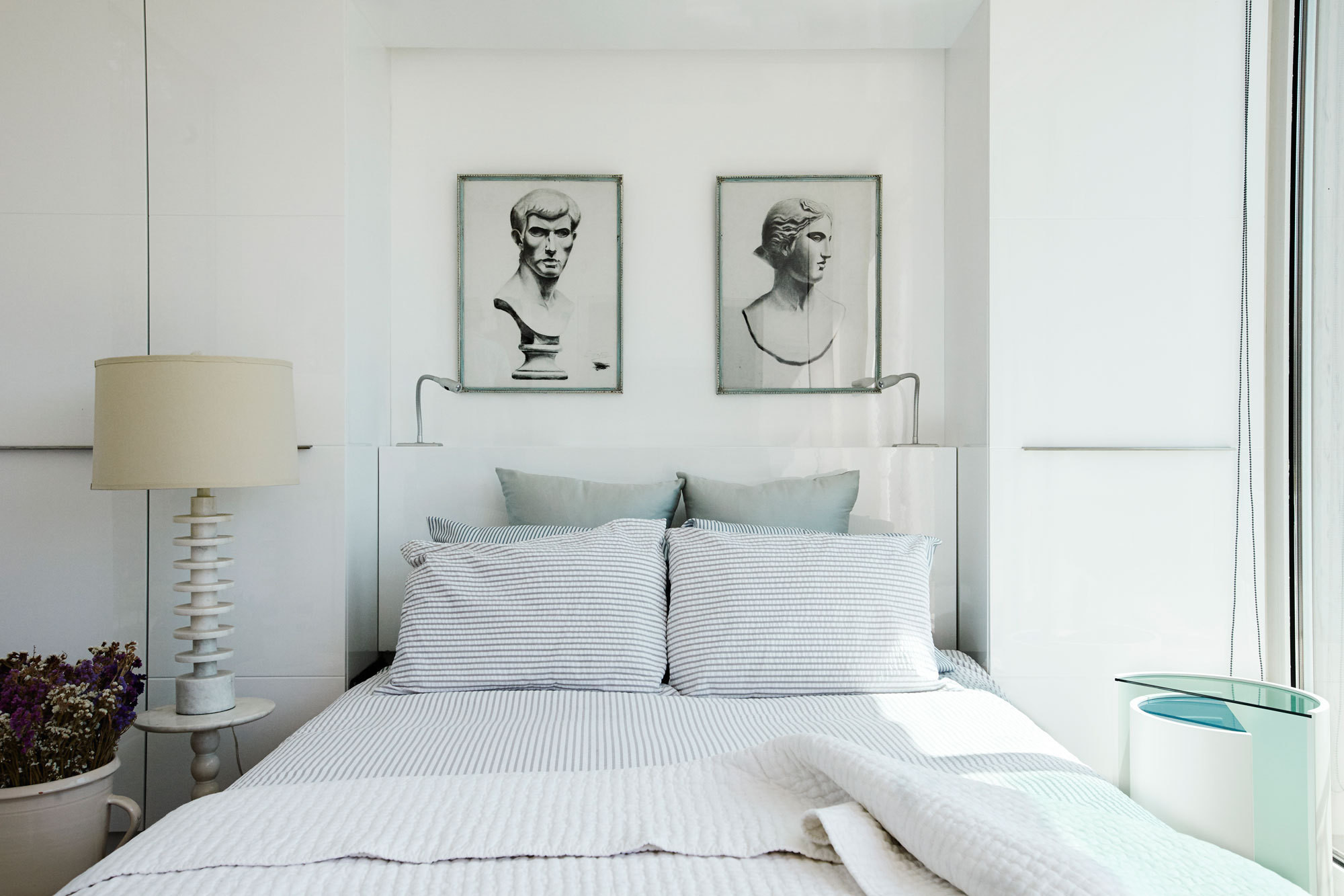 A pair of antiquities-themed artworks from Mecox Gardens presides over the bedroom.