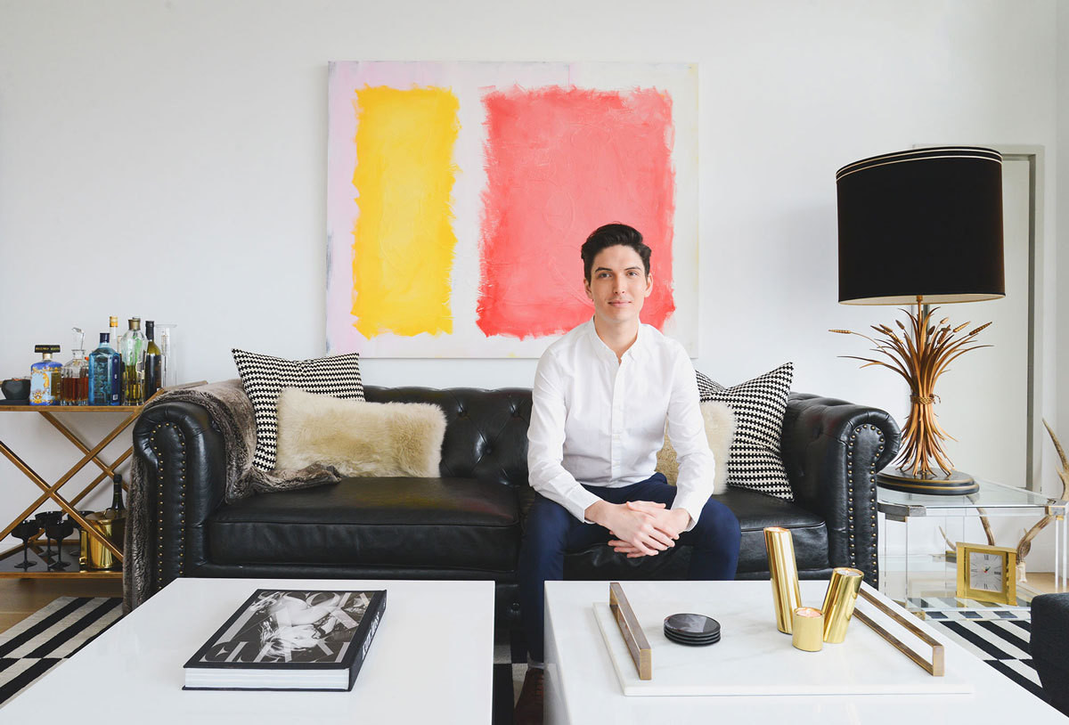 Noa Santos, co-founder and CEO of Homepolish, in the living room of his Hell's Kitchen, New York, apartment.