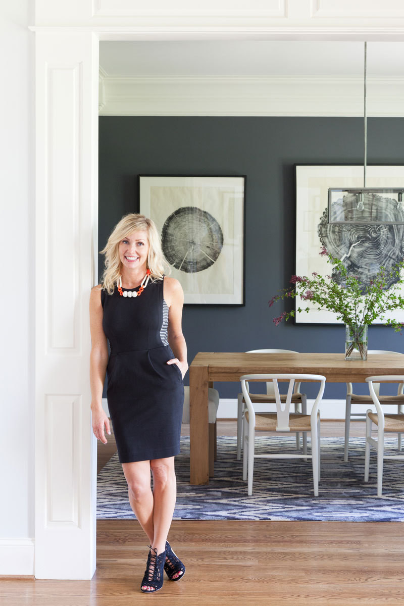 Interior designer Hannah Crowell in her client's moody dining room.