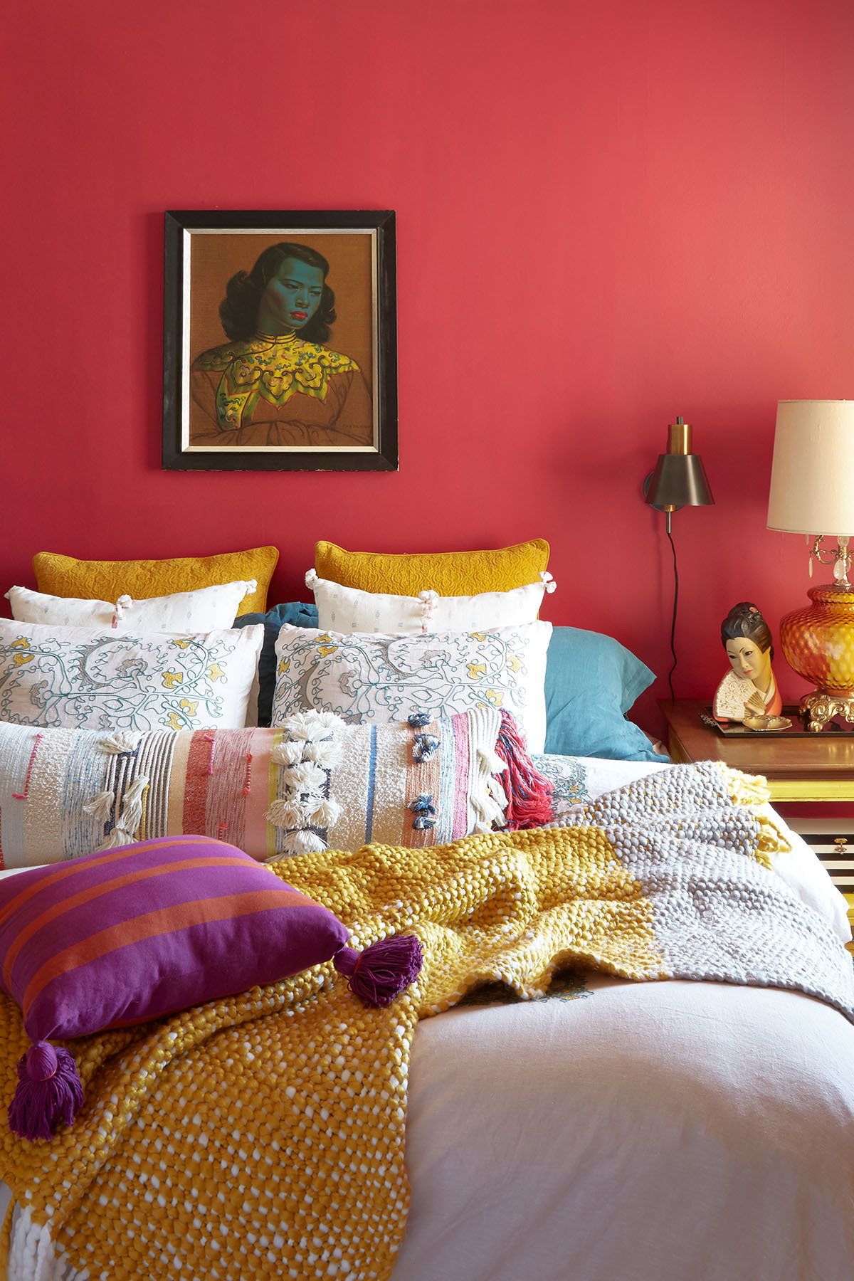 """Summer layers her bedroom with cozy throws and bedding by Anthropologie, West Elm, and Bed Bath & Beyond. """"You can tell I worked atBetsey Johnson in the 90s, going by my bedroom color scheme.""""Vladimir Tretchikoff Artwork 