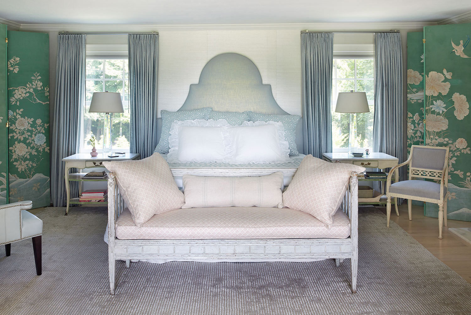 A pair of chinoiserie panels sourced in an antiques shop in Palm Springs, California, frames the bed in Annie Selke's master suite.