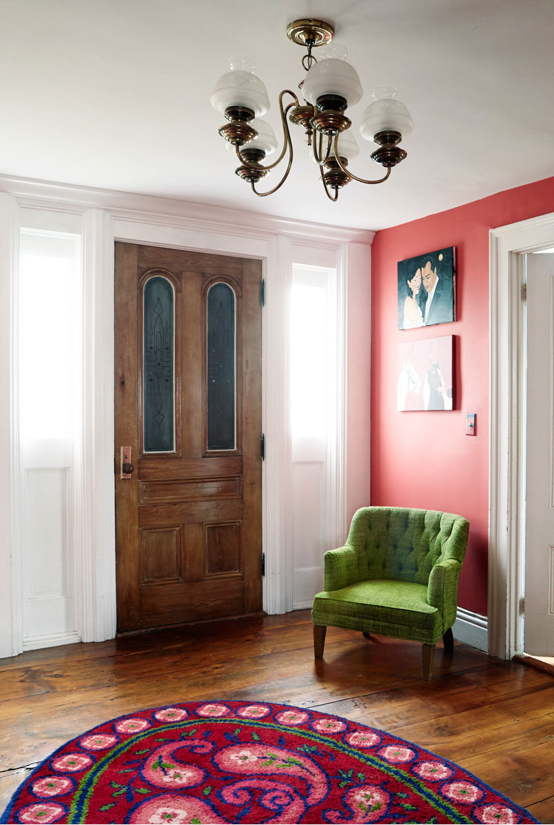 Bold color enlivens the main home's entry.