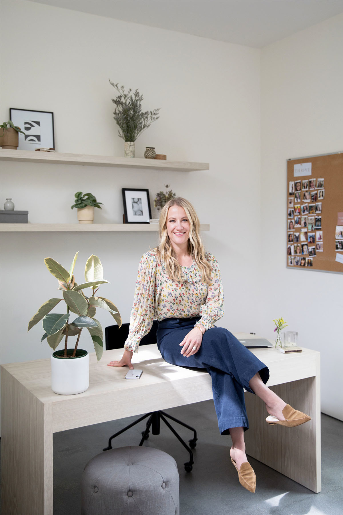 Stevens, who runs her business from home, ensures her office space is both calming and efficient. Sara Karkenny Desk | Sara Karkenny Custom Shelving | CB2 Desk Chair | West Elm Assorted Frames | Sanso Potted Plants | Sara Karkenny Ceramics.