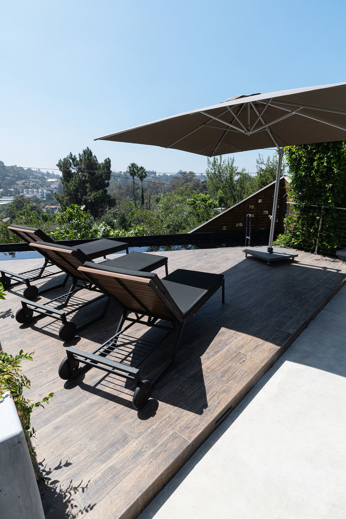 """The floor plan and design of our home really leans in to indoor-outdoor living,"" explains the designer. Crate & Barrel Loungers 