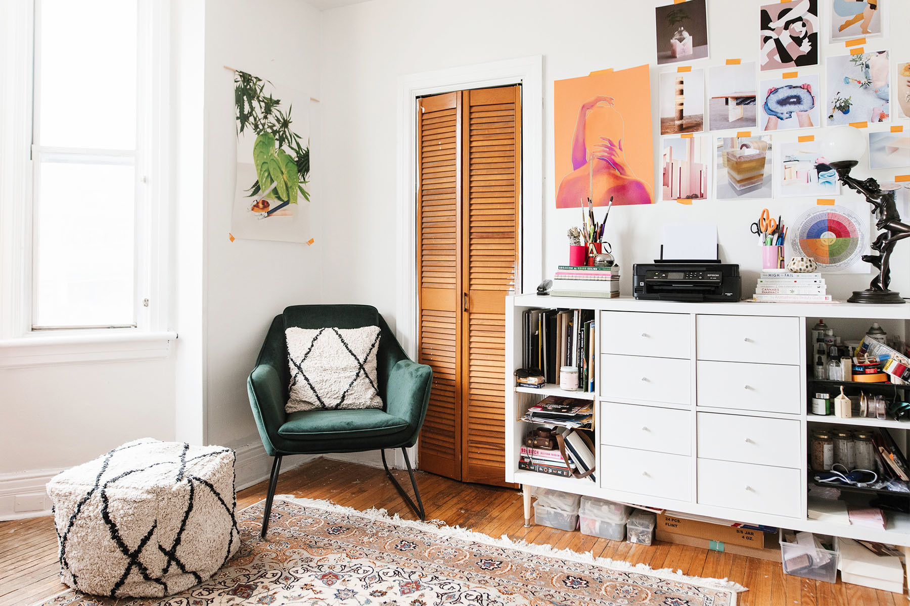 Sackville & Co. co-founder Hayley Dineen's Toronto home boasts a light, bright workroom and studio. Structube Armchair | Vintage Area Rug | Structube Pillow | Structube Pouf | IKEA Shelves | Duncan Foy Print.